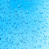 Water droplets. On a blue background Royalty Free Stock Photos