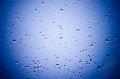 Water droplets on the blue gla Stock Photography