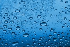 Water drops. Water droplets on blue glass surface Royalty Free Stock Image