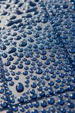 Water droplets on Blue Plate Royalty Free Stock Image