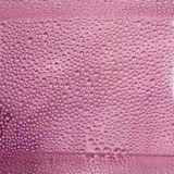 Water Droplets on bucket pink.  royalty free stock photo