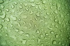 Water droplets on canvas. Water droplets on a green canvas Stock Photo