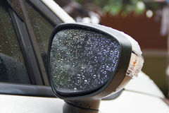 Water droplets on a car rear Stock Images