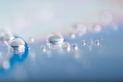 Water droplets on cd. Abstraction. Water on compact disc surface Stock Images