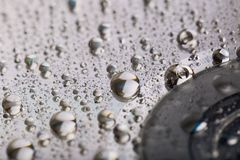 Water droplets on cd. Abstraction. Water on compact disc surface Stock Image