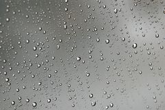 Water Droplets Closeup. A closeup of the water droplets on a clear weather screen (shallow depth of field stock photos