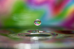 Water drops on colorful background Stock Images
