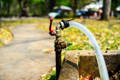 Water droplets at faucet. At park royalty free stock photo