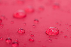 Water droplets on is fiber Waterproof fabric colorful.  stock photo