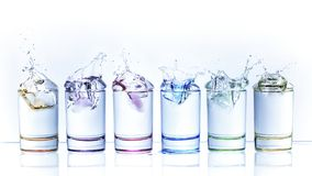 Free Water Droplets From Dropping An Ice Cube Into A Glass Of Liquid Stock Images - 133469624
