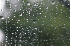 Water droplets on glass stock image