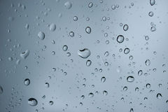 Water droplets on glass royalty free stock images