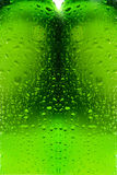 Water droplets on glass bottle. Green bottle with water droplets Royalty Free Stock Image