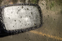 Water droplets on glass. Water droplets on glass and Car side mirror Royalty Free Stock Photos