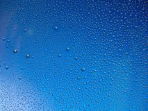 Water droplets on the glass with a colored background. Drops of water royalty free stock photo