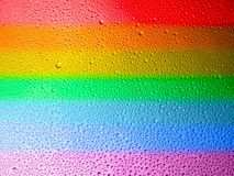 Water droplets on the glass with a colored background. Drops of water. lgbt stock images