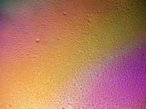 Water droplets on the glass with a colored background. Drops of water stock photography