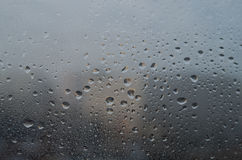 Water droplets on glass Stock Images