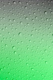 Water droplets on a green and grey Stock Image