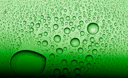 Water droplets on a green surface Stock Photo