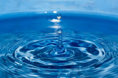 Water droplets  higher on blue  background Stock Photography