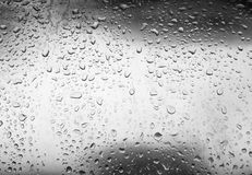 Water droplets on metallic surface Stock Images