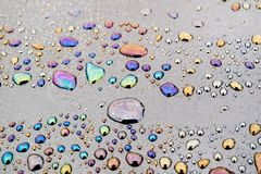 Water Droplets Mixed With Petroleum Products, Because Of This On The Water Different Patterns Of Different Color Stock Images