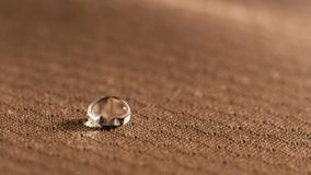 Water droplets on moisture resistant fabric Close up. Macro stock images