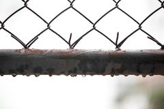 Water droplets on old steel grilles with warm light. On background blurred royalty free stock photos