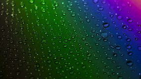 Water droplets on rainbow light background stock photography