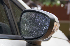 Water droplets on rear-view mirror Stock Image