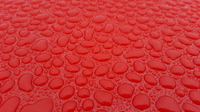 Water droplets on red surface Royalty Free Stock Image