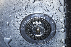 Water and droplets in sink. BLUE Water and droplets in sink royalty free stock photos