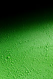 Water droplets spread across gradient background Royalty Free Stock Photography