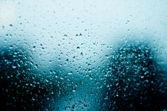 Water droplets texture. Over blue background Stock Images