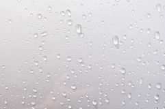 Water dropped on the metallic car Royalty Free Stock Photos