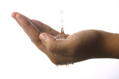 Water dropping on hand Royalty Free Stock Image