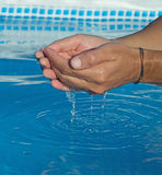 Water dropping from man hands Stock Image