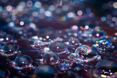 Water drops. On cd with flash causes this spectrum effect Stock Photography
