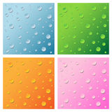 Water drops. Set of four water drops backgrounds in four tones:blue,green,orange and pink.Isolated on white background.EPS file available Stock Photography