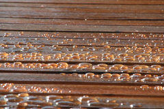 Water Drops. On Wood Deck Royalty Free Stock Images