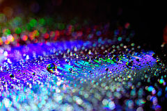 Water drops. On a rainbow background Stock Image