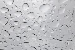 Water drops. Water rain droplets on glass background drop stock photo