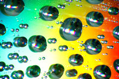 Water drops. Close up of water drops on color background Royalty Free Stock Image
