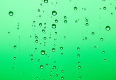 Water Drops. On green background Royalty Free Stock Photos