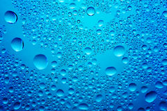 Water drops. Water splashes, dark blue color Royalty Free Stock Images