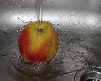 The water drops. Apple and the water drops Stock Photo