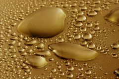 Water drops. Golden colored water drops (macro Royalty Free Stock Photo