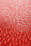 Water drops. On a red background Royalty Free Stock Photos