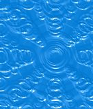 Water drops. Abstracted and imprinted rings of water drops on blue Stock Images